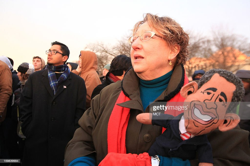 Sharyn Pinney, 62, of Dallas, Texas holds a President Obama doll she collected from Austin, Texas, which she holds as she stands on the National Mall during the 57th presidential inauguration festivities for President Barack Obama on the National Mall in Washington, D.C., January 21, 2013.