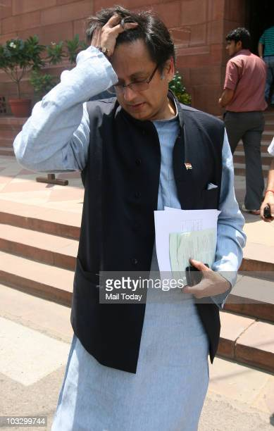 Shashi Tharoor arrives for the ongoing monsoon session of Parliament in New Delhi on Friday