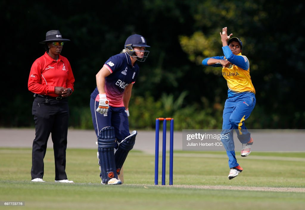 Shashikala Siriwardena of Sri Lanka bowls past ICC Umpire Jacqueline Williams during The ICC Women's World Cup warm up match between England and Sri Lanka at Queens Park on June 19, 2017 in Chesterfield, England.