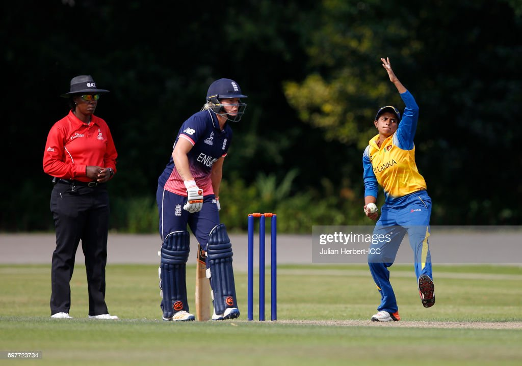 Shashikala Siriwardena of Sri Lankabowls past ICC Umpire Jacqueline Williams during The ICC Women's World Cup warm up match between England and Sri Lanka at Queens Park on June 19, 2017 in Chesterfield, England.