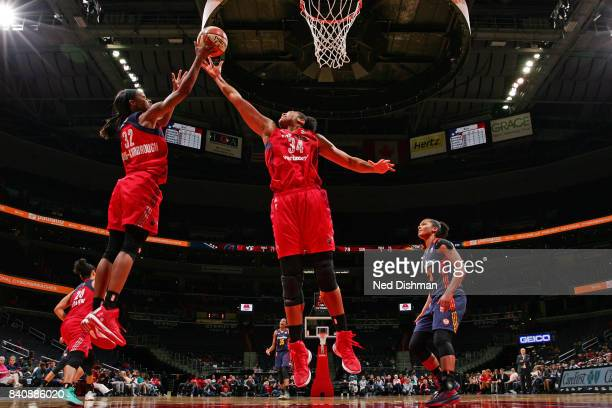 Shatori WalkerKimbrough and Krystal Thomas of the Washington Mystics go up for a rebound during a WNBA game against the Connecticut Sun on August 29...