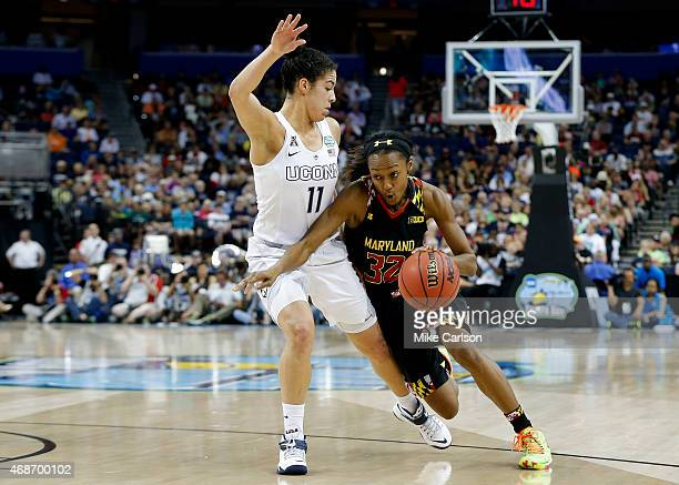 Shatori WalkerKimbrough of the Maryland Terrapins drives against Kia Nurse of the Connecticut Huskies in the second half during the NCAA Women's...