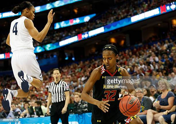 Shatori WalkerKimbrough of the Maryland Terrapins drives against Moriah Jefferson of the Connecticut Huskies in the first half during the NCAA...