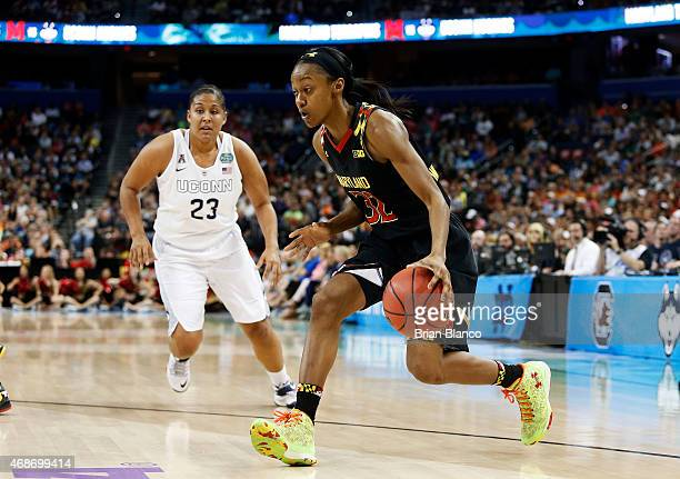 Shatori WalkerKimbrough of the Maryland Terrapins drives against Kaleena MosquedaLewis of the Connecticut Huskies in the first half during the NCAA...