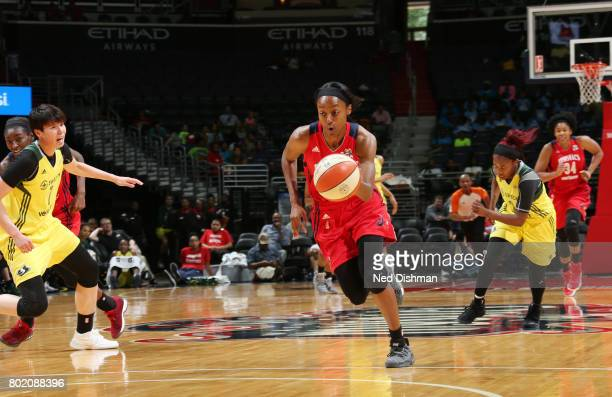 Shatori WalkerKimbrough of the Washington Mystics brings the ball up court against the Seattle Storm on June 27 2017 at the Verizon Center in...