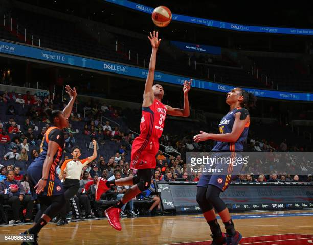 Shatori WalkerKimbrough of the Washington Mystics drives to the basket and shoots the ball against the Connecticut Sun during a WNBA game on August...