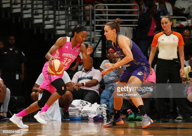Shatori WalkerKimbrough of the Washington Mystics drives to the basket against the Phoenix Mercury on August 18 2017 at the Verizon Center in...