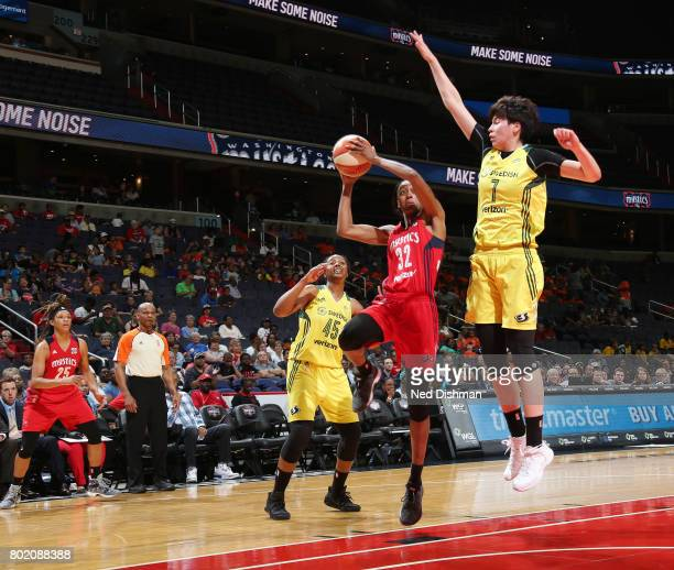 Shatori WalkerKimbrough of the Washington Mystics goes for a lay up against Ramu Tokashiki of the Seattle Storm on June 27 2017 at the Verizon Center...