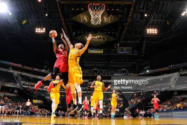 Shatori WalkerKimbrough of the Washington Mystics goes for a lay up during the game against Jazmon Gwathmey of the Indiana Fever during a WNBA game...