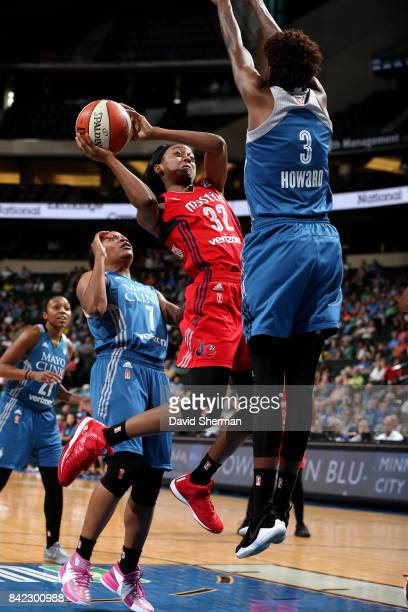 Shatori WalkerKimbrough of the Washington Mystics goes for a lay up against Natasha Howard of the Minnesota Lynx on September 3 2017 at Xcel Energy...