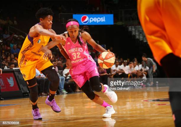 Shatori WalkerKimbrough of the Washington Mystics handles the ball against Alana Beard of the Los Angeles Sparks on August 16 2017 at the Verizon...
