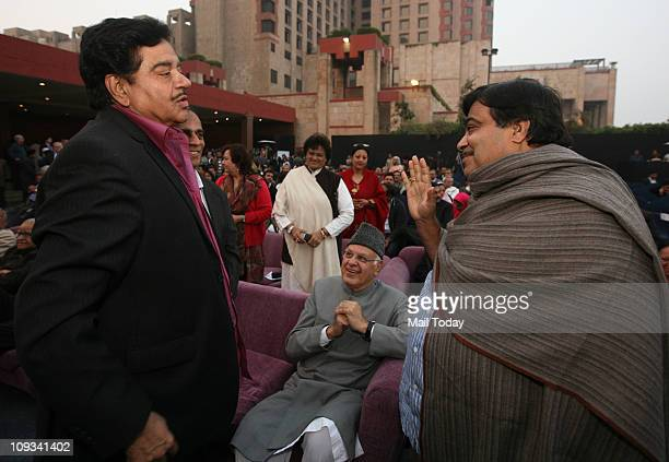 Shatrughan Sinha talking with BJP President Nitin Gadkari while Farooq Abdullah looks on during the launch of the book 'Impressions' written by BJP...