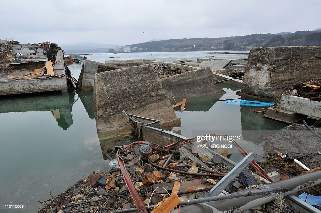 A shattered breakwater, broken by a tsunami, lies in Minamisanriku, Miyagi prefecture on March 15, 2011 following a massive earthquake and tsunami on March 11. Japan's government on March 15 urged people against panic-buying of food and supplies, as the country grapples with an earthquake and tsunami and resulting nuclear crisis.