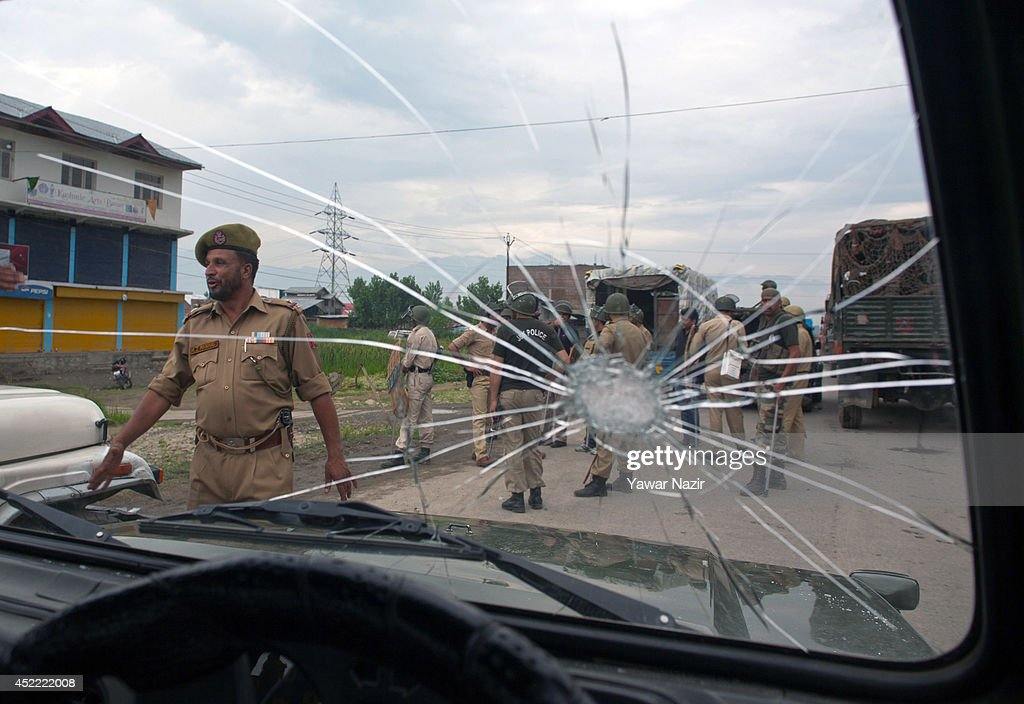 A shattered glass of an Indian army vehicle is seen after clashes with Indian government forces after a cab was hit by an Indian Army vehicle killing...