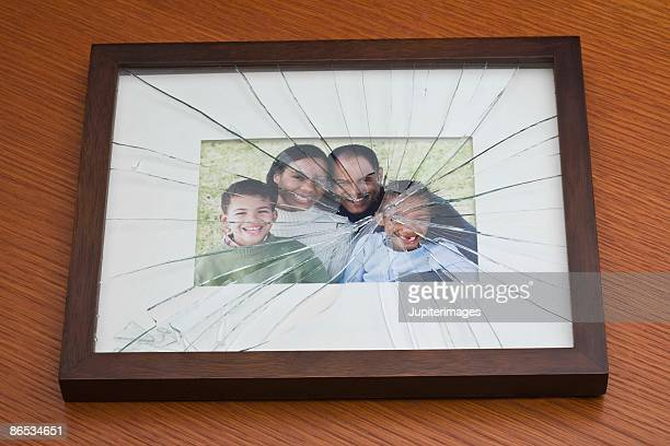 Shattered glass on family portrait