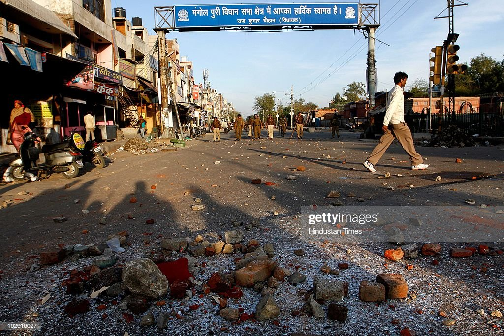 Shattered glasses and bricks lying on road as a mob ransacked hospital and public vehicle near Sanjay Gandhi hospital during a protest after an eight-year-old girl, student of Class 2, was allegedly raped inside the premises of a North Delhi Municipal Corporation school at Mangolpuri Area on March 1, 2013 in New Delhi, India.