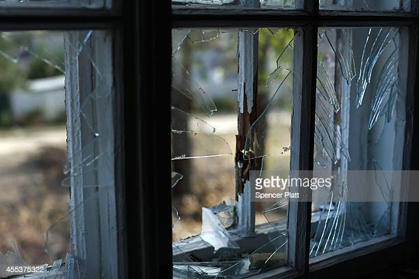 A shattered window is viewed among the remains of an elementary school that has been turned into an bomb shelter in the war battered city of Lugansk...
