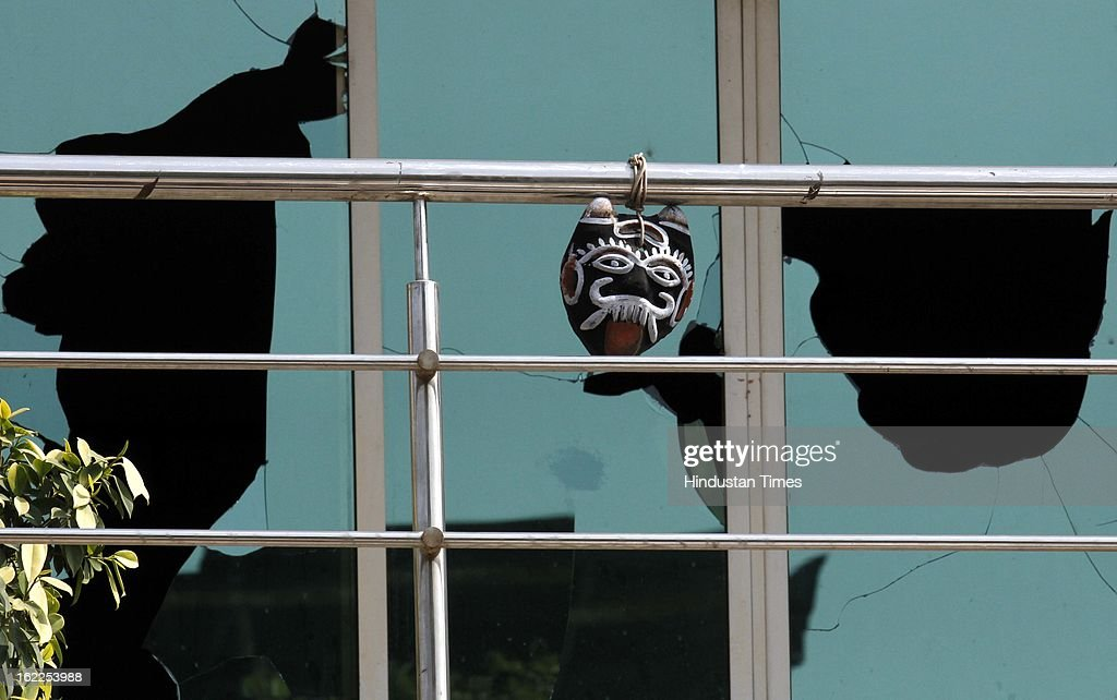 Shattered window panes as seen after the trade union activists pelted stones on the factories at Okhla phase 2 on the second day of all India Trade Union strike on February 21, 2013 in New Delhi, India.