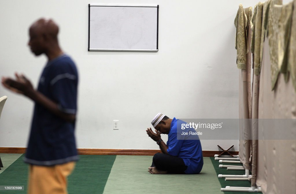 Shaukat Ali (R) prays during an evening prayer on the first day of Ramadan at the Islamic Center of Greater Miami on August 1, 2011 in Miami, Florida. Worlwide Muslims honor Ramadan with the sighting of the new moon and is marked with fasting each morning at dawn and ends in the evening at dusk of each day for the next month, culminating in the three-day Eid ul-Fitr celebration