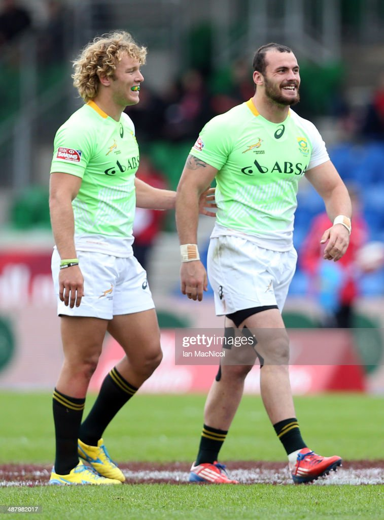 Shaun Adendorff of South Africa is congratulated by Werner Kok of South Africa after the game against Samoa during the IRB Glasgow Sevens at...