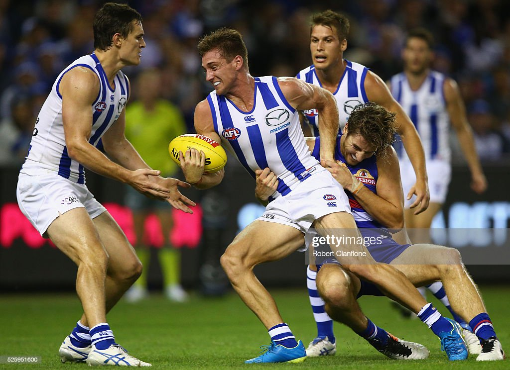 Shaun Atley of the Kangaroos is tackled by Marcus Bontempelli of the Bulldogs during the round six AFL match between the North Melbourne Kangaroos and the Western Bulldogs at Etihad Stadium on April 29, 2016 in Melbourne, Australia.