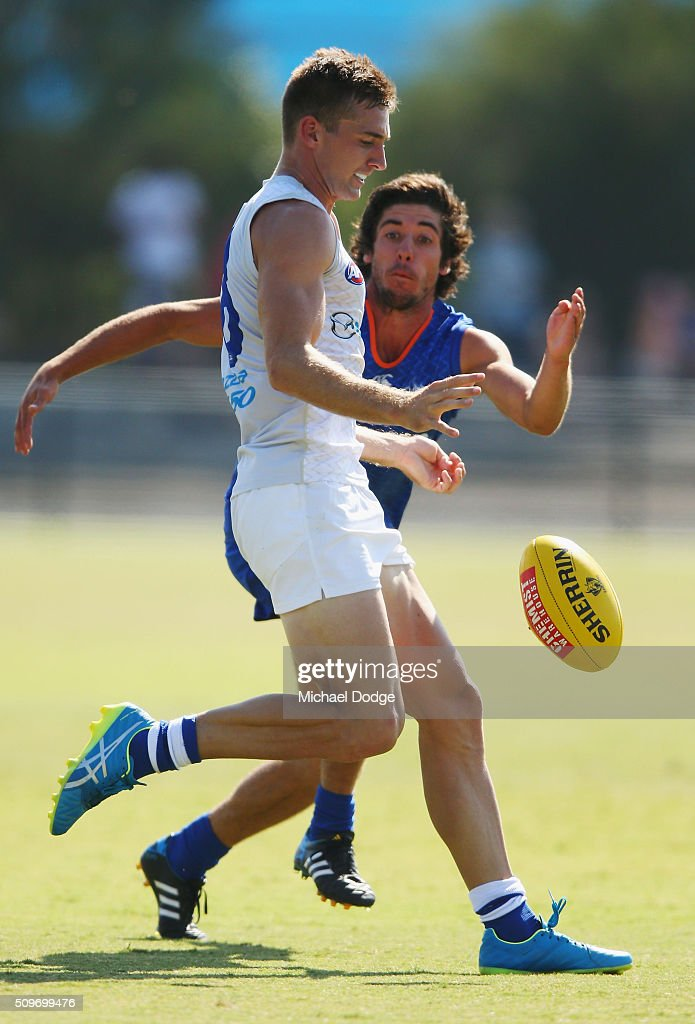 Shaun Atley of the Kangaroos kicks the ball uring the North Melbourne AFL Intra-Club match at Arden Street Ground on February 12, 2016 in Melbourne, Australia.