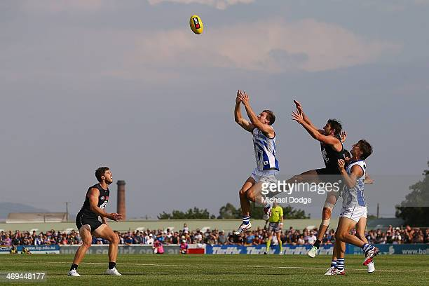 Shaun Atley of the Kangaroos marks the ball against Jarrad Waite of the Blues during the round one AFL NAB Cup match between the North Melbourne...
