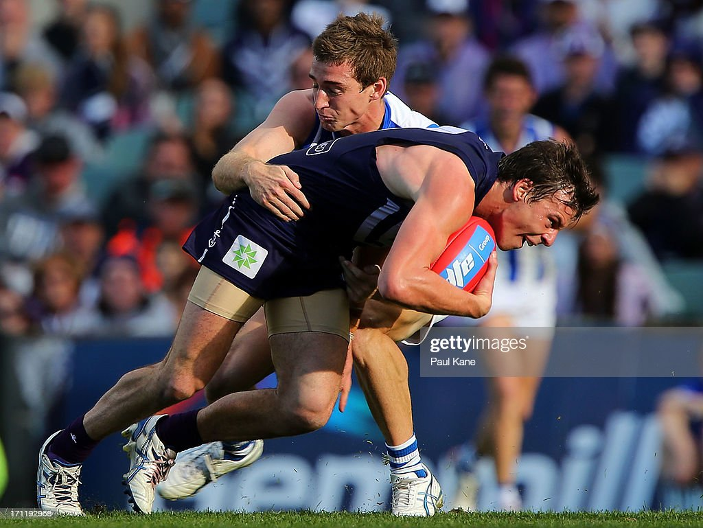 Shaun Atley of the Kangaroos tackles Nick Suban of the Dockers during the round 13 AFL match between the Fremantle Dockers and the North Melbourne Kangaroos at Patersons Stadium on June 23, 2013 in Perth, Australia.