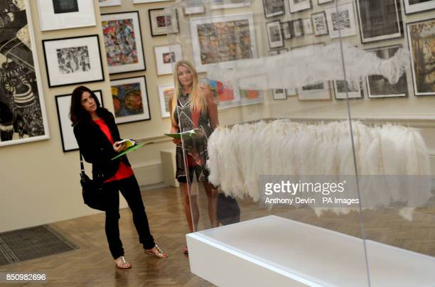 Shaun Boyle and Aly Garvey look at Dreamcatcher by Marilene Oliver during the press view of the Royal Academy summer exhibition Burlington House...