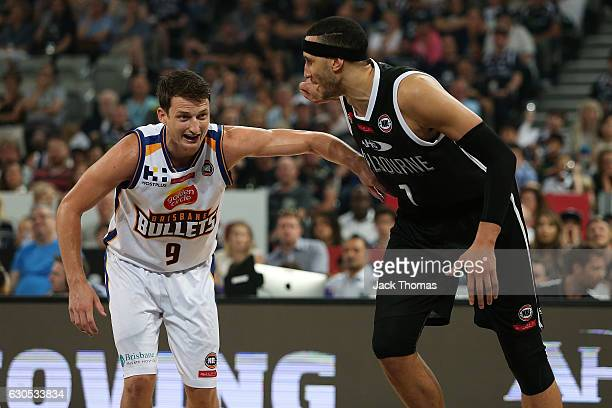 Shaun Bruce of the Brisbane Bullets and Josh Boone of Melbourne United compete for the rebound during the round 12 NBL match between Melbourne and...
