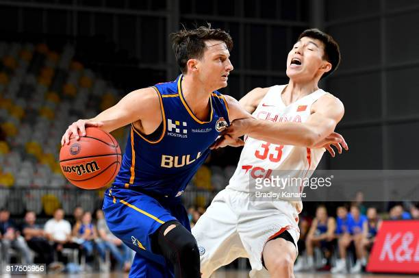 Shaun Bruce of the Bullets takes on the defence of Wu Qian of China during the match between the Brisbane Bullets and China at the Gold Coast Sports...