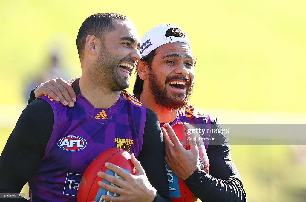 Shaun Burgoyne and Cyril Rioli of the Hawks laugh during a Hawthorn Hawks AFL training session at Waverley Park on August 5, 2016 in Melbourne, Australia.