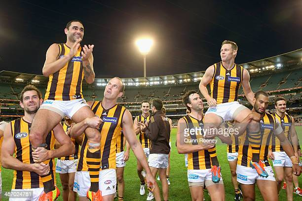 Shaun Burgoyne and Sam Mitchell of the Hawks are chaired off the field in their 250th games during the round six AFL match between the Richmond Tiges...
