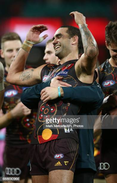 Shaun Burgoyne of the Hawks and Hawks head coach Alastair Clarkson embrace after victory in the round 10 AFL match between the Sydney Swans and the...