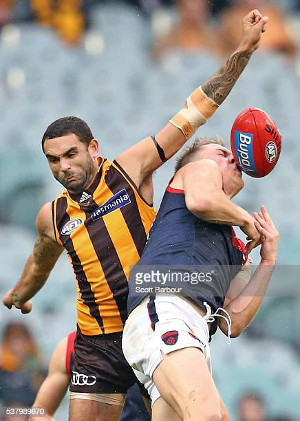 Shaun Burgoyne of the Hawks and Tom McDonald of the Demons compete for the ball during the round 11 AFL match between the Hawthorn Hawks and...