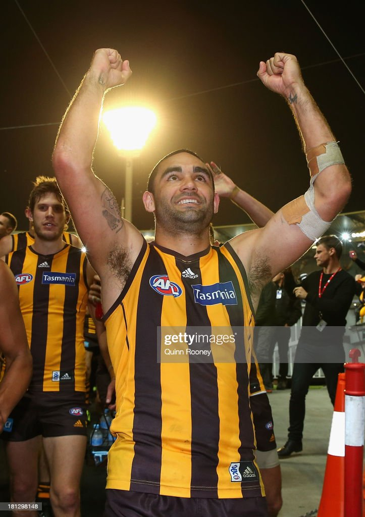 Shaun Burgoyne of the Hawks celebrates winning the AFL First Preliminary FInal match between the Hawthorn Hawks and the Geelong Cats at Melbourne Cricket Ground on September 20, 2013 in Melbourne, Australia.