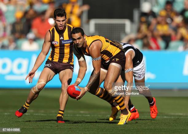 Shaun Burgoyne of the Hawks gathers the ball during the round six AFL match between the Hawthorn Hawks and the St Kilda Saints at University of...