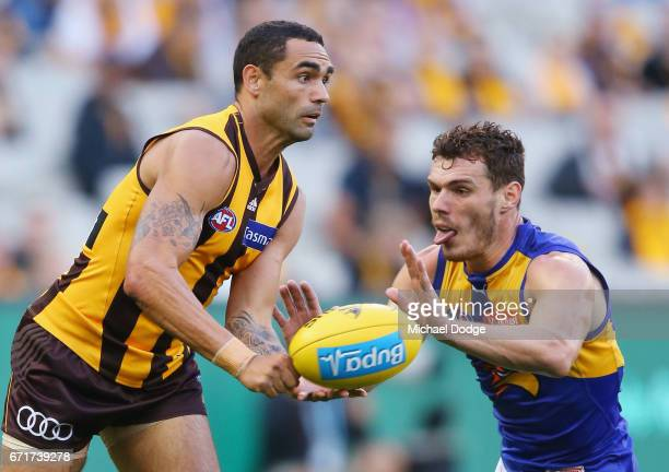 Shaun Burgoyne of the Hawks handballs past Luke Shuey of the Eagles during the round five AFL match between the Hawthorn Hawks and the West Coast...