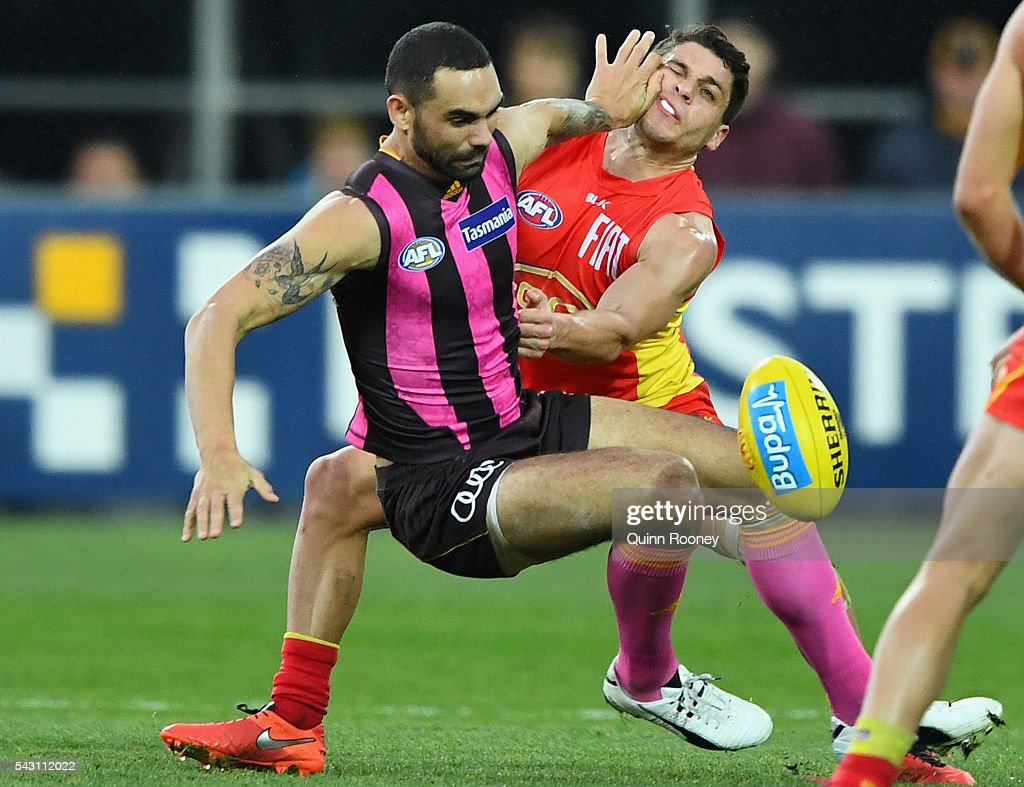 Shaun Burgoyne of the Hawks is tackled by Dion Prestia of the Suns during the round 14 AFL match between the Hawthorn Hawks and the Gold Coast Suns at Aurora Stadium on June 26, 2016 in Launceston, Australia.