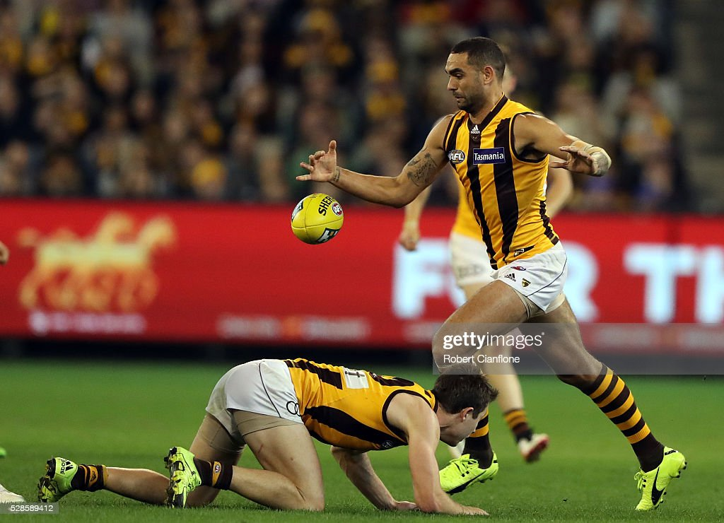 <a gi-track='captionPersonalityLinkClicked' href=/galleries/search?phrase=Shaun+Burgoyne&family=editorial&specificpeople=224566 ng-click='$event.stopPropagation()'>Shaun Burgoyne</a> of the Hawks kicks the ball during the round seven AFL match between the Richmond Tigers and the Hawthorn Hawks at Melbourne Cricket Ground on May 6, 2016 in Melbourne, Australia.