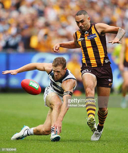 Shaun Burgoyne of the Hawks kicks the ball off the ground dangerously near the head of Joel Selwood of the Cats during the round one AFL match...
