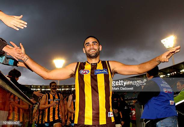 Shaun Burgoyne of the Hawks leads the team off the ground after their win in the round 11 AFL match between the Hawthorn Hawks and the Port Adelaide...