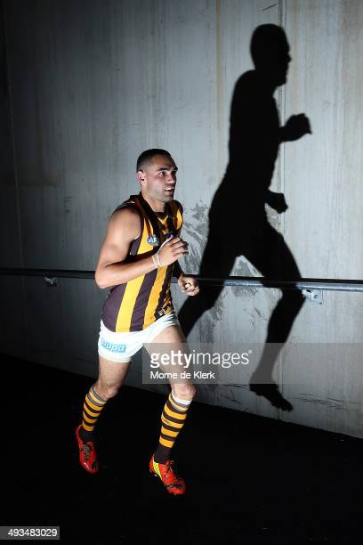 Shaun Burgoyne of the Hawks runs onto the field during the round 10 AFL match between the Port Adelaide Power and the Hawthorn Hawks at Adelaide Oval...