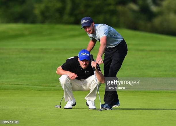 Shaun Collins of Hertfordshire Golf and Country Club and Ben Talbot of Marriott Hanbury Manor Golf Club line up a putt on the 18th green during the...
