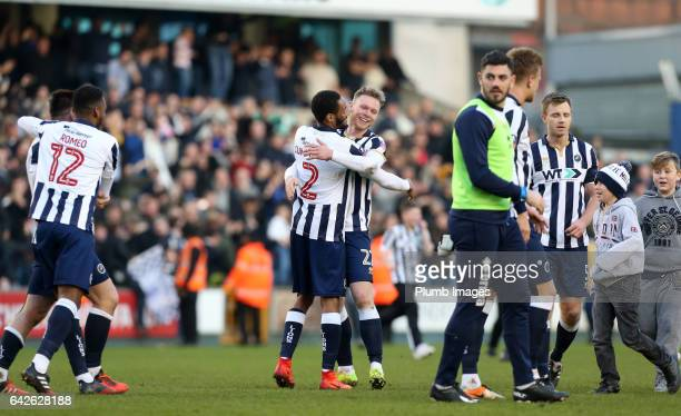 Shaun Cummings and Aiden O'Brian of Millwall celebrate after The Emirates FA Cup Fifth Round tie between Millwall and Leicester City at The Den on...