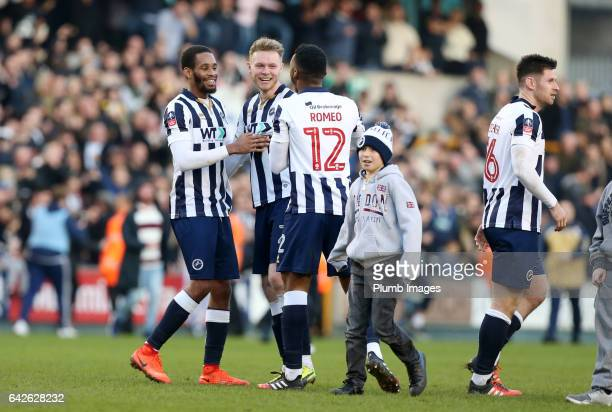 Shaun Cummings Mahlon Romeo and Aiden O'Brian of Millwall celebrate after The Emirates FA Cup Fifth Round tie between Millwall and Leicester City at...
