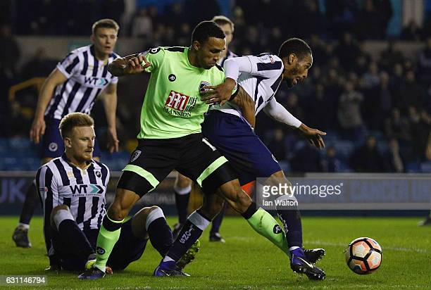 Shaun Cummings of Millwall and Callum Wilson of AFC Bournemouth compete for the ball during the Emirates FA Cup third round match between Millwall...