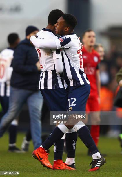 Shaun Cummings of Millwall and Mahlon Romeo of Millwall celebrate after The Emirates FA Cup Fifth Round match between Millwall and Leicester City at...
