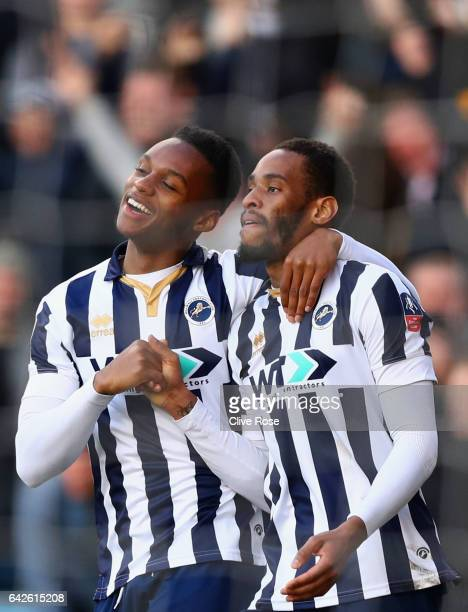 Shaun Cummings of Millwall celebrates scoring his sides first goal with Mahlon Romeo of Millwall during The Emirates FA Cup Fifth Round match between...