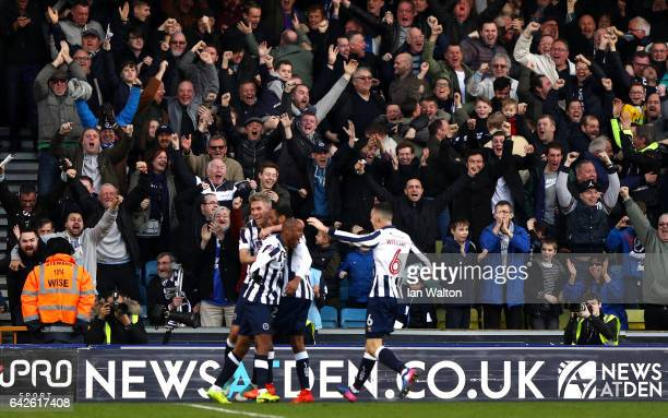 Shaun Cummings of Millwall celebrates scoring his sides first goal with his Millwall team mates during The Emirates FA Cup Fifth Round match between...